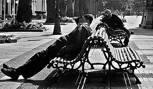 A couple of guys sleeping near the Kiosko Alfo...