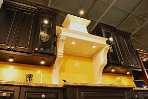 TAMA Custom Designs displaying kitchens at the...