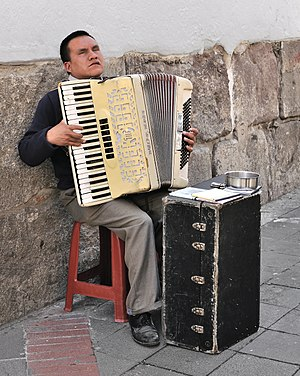 English: Accordion player in a street in the h...