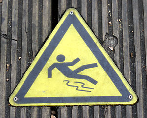 icon for public signs warning that the ground ...