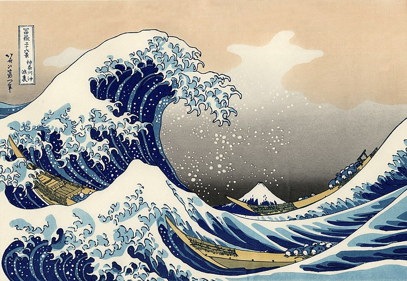 An image of 'The Great Wave Off Kanagawa,' a famous print by Hokusai. The image is a blockprint of huge waves which are swallowing up tiny boats.