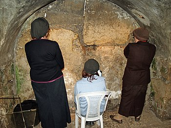 Women praying in the Western Wall tunnels. Thi...