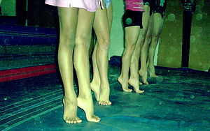 Young gymnasts on tiptoes.