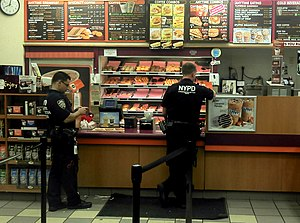 English: Two NYPD cops in a Dunkin Donuts on H...