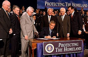President George W. Bush signs the Homeland Se...