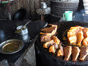 English: Fish frying at a local food joint.