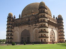 7-storey domed building with 4 domed corner towers