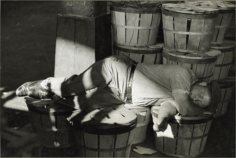 Man sleeping in fish market. Baltimore, Maryland.