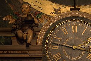 12-hour clock and cherub