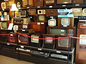 A display of old televisions, VCRs and radios ...