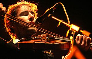 English: Andrew Bird with violin in concert Ca...