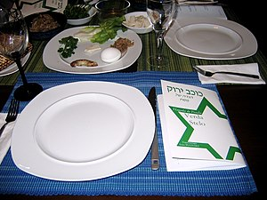 Passover Seder table with an Esperanto Haggada...