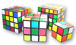 Variations of Rubik's Cubes (from left to right: Rubik's Revenge, Rubik's Cube, Professor's Cube, & Pocket Cube)