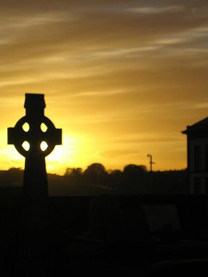 English: A Celtic Cross in the Sunset, St. Mar...