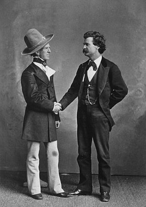 Mark Twain in a handshake with John T. Raymond...