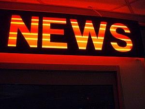 """Neon sign displaying """"News"""""""