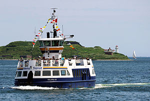 English: The Halifax III crossing the harbour ...