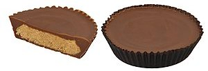 Reese's Peanut Butter Cups, one with wrapper a...