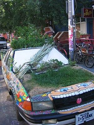 Eco car in Kensington Market, Toronto, Canada.