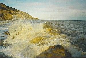 Waves crashing on the Rocks at the foot of Fai...