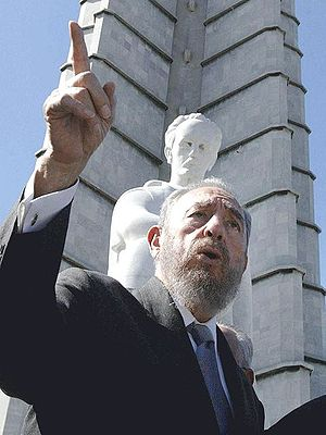 Castro, in 2002, beneath a statue of José Martí