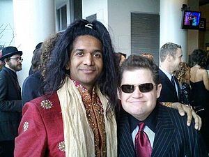 Anand Bhatt (left) and Patton Oswalt (right) a...