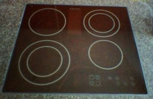 A :en:glass-ceramic cooktop. Model of :en:2004...