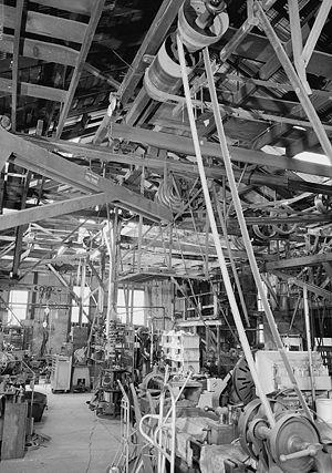 Line shaft and belt driven machinery. MACHINE ...