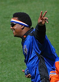 Pedro Martinez waves goodbye after signing some autographs