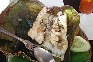 Chicken rice baked in a banana leaf