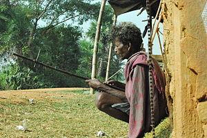 Early morning an adivasi tribal elder prepares...