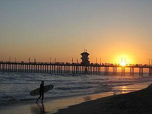 Surfers abound near Huntington City Pier