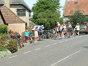 English: Cyclists at the Wise Man. A busy scen...