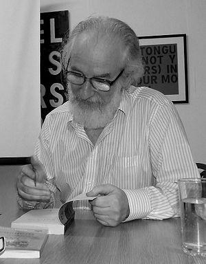 English: David Crystal signing a book at the H...