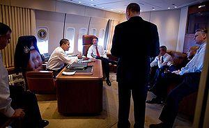 Aboard Air Force One, President Barack Obama t...