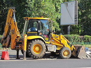 English: A JCB 3CX Backhoe Loader on outrigger...