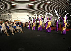 US Navy 090226-N-4236E-047 Sailors and Marines watch a dance performance during a Black History Month celebration.jpg