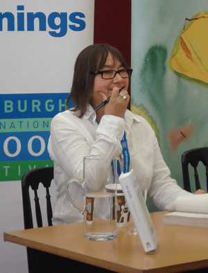 English: Ali Smith, writer, signing books at t...