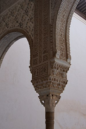 Capital, column and arch in Alhambra of Granad...