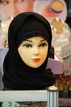 Mannequin doll head with a black hijab headsca...