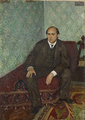 English: Arnold Schoenberg seated, painted in ...
