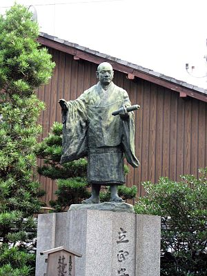 A statue of Nichiren outside Honnoji temple on...