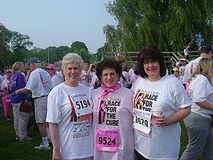 A group participating in a Komen Race for the ...