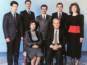 The al-Assad family, c. 1993. At the front are Hafez and his wife, Anisa. At the back row, from left to right: Maher, Bashar, Bassel, Majd, and Bushra