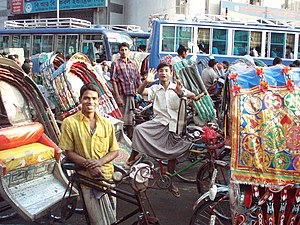 Cycle rickshaws and their drivers, standing, s...