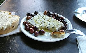 Simple meze of feta cheese and olives: charact...