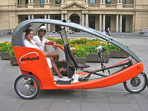Pedicab rickshaw in front of Sydney Customs Ho...