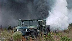 A smoke screen being laid by a military vehicle