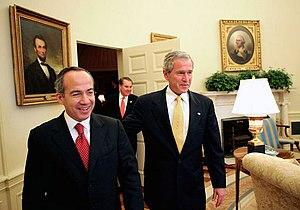 Felipe Calderón, president of Mexico (left) an...