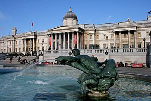 Fountain in Trafalgar Square, with the Nationa...